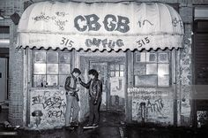 Two unidentified young men in leather jackets stand outside CBGB (at 315 Bowery) on Valentine's Day, New York, New York, February 14, 1983. (Photo by Jack Vartoogian/Getty Images)