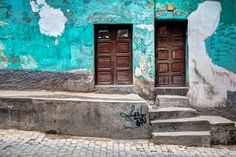 Turquoise wall with brown doors