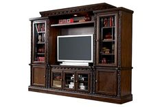 """The North Shore Entertainment Center from Ashley Furniture HomeStore (AFHS.com). A rich traditional design and exquisite details come together to create the ultimate in Old World style with the """"North Shore"""" entertainment wall."""