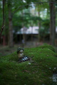 Moss covered little Ksitigarbha (Jizo) statue in Kyoto, Japan