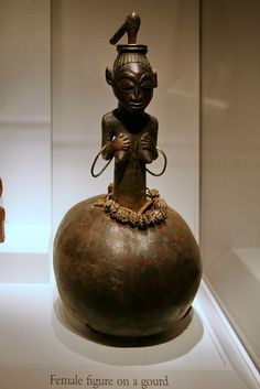 Female figure on a gourd, Akan peoples, Ghana, Late 19th to early 20th century  Terracotta