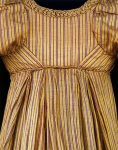 ca. 1805.  Love the stripes and the braided trim around the neckline.