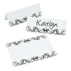 Black & White Place Cards - they go with the invites we saw at party city. Bet we can find similar at Hobby Lobby