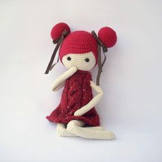 Love the style of this doll.  Thin, long arms and legs with no hands or feet, large head.  Love the crocheted flat hair.