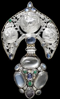 Buckle and belt tag: London ca. 1905.   Wilson, Henry (designer). Silver, cast, chased, enamelled and mounted with cabochon-cut stones.