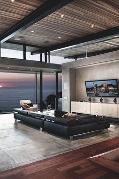 Sala de TV moderna decorada com piso de cimento queimado