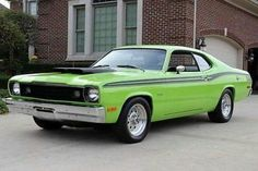 1973 Plymouth Duster 340/4 spd.  When the gov. started making car manufactures put pollution control on muscle cars Chrysler answer was bright colors. This is Sublime Green!  The 4spd didn't hurt...       `™`