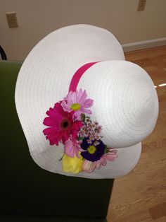 DIY  Last year s Kentucky Derby hat. Buy a cheap hat at Target and sew on  fresh flowers. 365ac5205a6