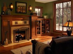 Craftsman Living Room with Hardwood floors, metal fireplace, Built-in bookshelf, Wall sconce