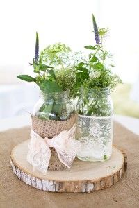bohemian wedding details... white and natural tables with purple, greens, white & peach flowers/vases.