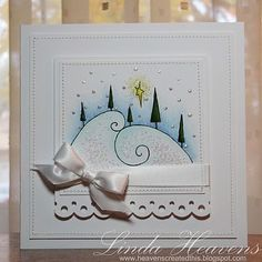 Stamping Bella's swirly hills with trees