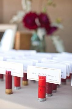 Shot Gun Shells for escort cards - hahaha good idea! I think I might use them to display our pictures though, since Im not doing a seating chart =)