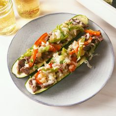 Confession: When making zucchini boats, we often forget to return the scooped out zucchini back to the mixture before baking (as evidenced in the video above). Do as we say, not as we do. You'll feel better making sure nothing goes to waste; plus, it's healthy. #easyrecipe #cheesesteak #zucchini #lowcarb #keto