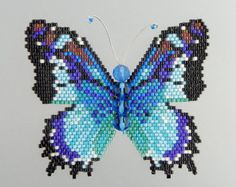 Create a dazzling rainbow Monarch butterfly using this 7 page beading pattern and tutorial in PDF format. You will receive the pattern, detailed instructions including technical drawings, photos and a material list; everything you need to successfully complete the butterfly in two colorways (rainbow and ombre pink) as pictured above. Using Delica cylinder beads, fire polished beads and brick stitch, your completed butterfly will be 2 1/4 inches (6 cm) tall and 1 1/2 inches (4.2 cm) and may…