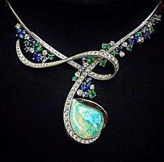 Emeralds, Sapphires, Diamonds, and Fire Opal necklace. #opals #opalsau #opalsaustralia