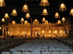 Temple theme wedding, gold wedding theme, temple bells, ceiling temple bells, lighting, banquet decor, telugu wedding setup, regal south indian wedding decor, traditional wedding decor
