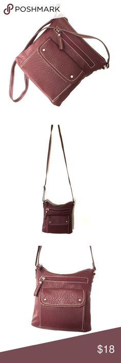 Maroon Crossbody Bag Like new condition! This crossbody bag goes from day to night easily with the dark maroon color. Zippered and magnetic closures throughout keep your things safe! 3 exterior pockets and 1 zippered interior pocket. Kelly & Katie. Man made material. Made in China. Kelly & Katie Bags Crossbody Bags