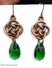 Copper Celtic knot charms and dark green Swarovski crystals, earrings.