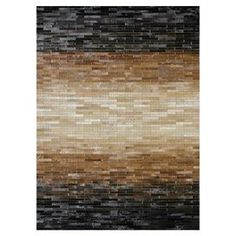Great cowhide rug.  Love the tones and the ombre affect.  Would be very dramatic in a room.  Would anchor a room too.