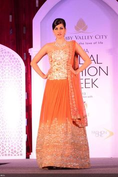 Orange Corset Reception Lehenga by Adarsh Gill