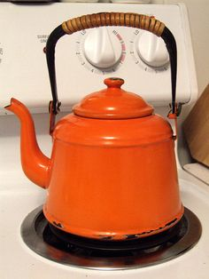 My old orange teapot just before it boiled dry and fused to the stove burner!