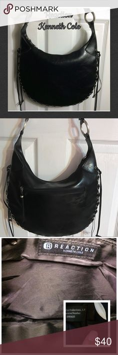 """Reaction Kenneth Cole Hobo Bag Cute, Clean, unique Handbag with braided leather ties going all around the edge of the bag(pic 4) with the ties hanging at top of braid on each side one zipper on back of bag and one inside with silver hardware...there are 3 of the 4 grommets missing on the hang ties and the handles do have some loose edging (pic 3) but can probably be glued...it measures 13"""" across 9.5"""" tall with a depth of .75"""" and a strap drop of 11.5""""...bundle to save more plus ⚡️ Kenneth…"""