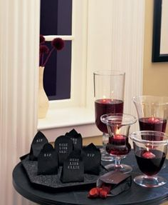 INSPIRATION: personalized treat bags in the shape of headstones; glass containers containing candles floating in fake blood