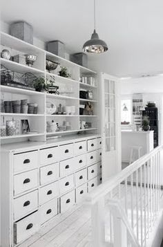 Scandinavian style relies on a limited tonal palette. Lots of stuff looks beautiful when it's similarly tones. And those drawers!