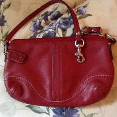 Coach red leather wristlet Cute wristlet. It is in good condition. 5 inches by 7.75 inches. Red leather Coach Bags Clutches & Wristlets