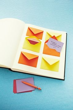"Guestbook Idea:    Mini envelopes and cards glued on pages of a photo album are neat and easy to keep. Memories are tucked away in a corner but can be easily reminisced as they are just a ""reach"" away."
