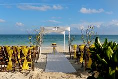 Beach Wedding at Secrets Capri, pretty ceremony set-up with yellow details.  Mexico wedding photographers Del Sol Photography @Secrets Capri Riviera Cancun