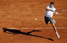 Gilles Simon of France returns the ball to Rafael Nadal of Spain during the semi-final of the Monte Carlo Masters in Monaco April 21, 2012.