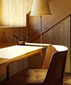 Interior in Switzerland by Pierre Yovanovitch: Bernt Petersens mahogany desk (c.1960) pine-wood chair by Axel Einar Hjorth (Swedenc.1930s) and brass floor lamp with wicker wrapping by Paavo Tynell for Taito Oy Finland (1940s). / Ad France     #nature #eatyourvegetables #art #heaven #decor #photooftheday #red #dinnertable #woodwork #architecture #dinner #handmade #custom #furniture #streetphotography #design #wood by mylluxury