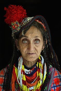 Kalash woman. Kalash people are believed to be descendants of Alexander the great's army mixed with the indigenous people of the Chitril district of Pakistan.Article:Bibi Kai, age 65, of the polytheistic Kalash tribe, who number only about 4,000.