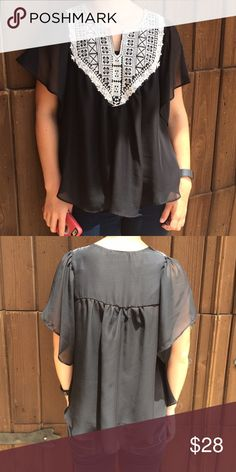 Boho Black Peasant Top Soooo cute! Perfect condition!  Worn once. Crochet embroidery detail at neckline. Flyaway sleeves. Sheer fabric - I am wearing a cami underneath.  Pullover style. Size Small. Boutique Tops Blouses