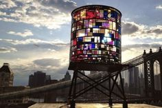 We are the light of the world; we are a city on a hill. Artist turns water tower into kaleidoscope on the waterfront in NYC..
