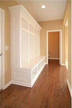 "JUST the colors… nothing else.  White trim, wood floors, warm almost-neutral walls.  (Whoever made that mudroom shelving unit stop about 10"" from the ceiling needs to be fired.)"
