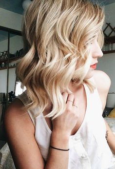 For ladies who are rocking a chic bob, style your hair with this wavy look for homecoming this year.