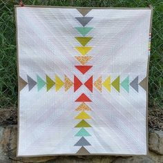 Stunning flying geese quilt! (It looks like it's quilted with colored thread, too!) Anyone know the original source/artist?