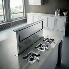 RISE - When the view from the window is too beautiful to be blocked by a typical kitchen hood, this is a perfect solution since it can be hidden inside the surface of the cooktop. When in use, it rises to 14 inches from the hob (almost twice the height of competitors) ensuring greater efficiency to clean air of the kitchen.