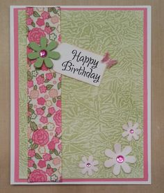 I had fun making the background for this card using a resist technique.  I also used alcohol ink to color the rhinestones in the flowers.
