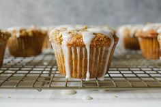 These hummingbird muffins are an adaption of traditional hummingbird cake. Moist and fluffy muffins topped with a brown butter streusel and sweet glaze.