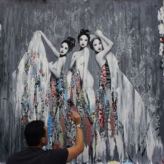 Street artist Hush puts the finishing touches on one of his Japanese style urban art murals.