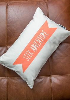 Inspired Space Pillow. Deck out your digs with this ivory throw pillow, which boasts a bright coral banner upon its organic cotton cover. #multi #modcloth