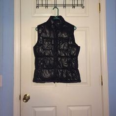 Black puffy vest New, never woren black vest. In great condition and willing to trade. Could fit a small or medium Jackets & Coats Vests