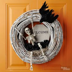 Its just-right scary aesthetic belies the simple construction of this spooky-theme wreath. Make the Halloween craft: Purchase a premade wreath -- this one is made of grapevine. Using acrylic spray paint, lightly cover with paint; when almost dry, rub off bits of the paint with sandpaper for a rough look. Tuck in a bit of grown moss as well as a few Halloween-theme accents -- here, a miniature crow, a small skeleton, some spiders, and a sign. You also can change the accents to make them more…