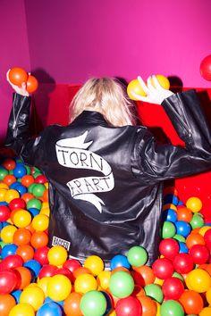 #DollsKill #lookbook #photoshoot #model @arielbees #TheRaggedPriest #shredder #biker #jacket #moto #black #leather #white #banner #scroll #torn #apart #ball #pit