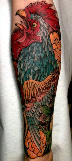 I personally would not get a chicken tattoo, but you have to admit that the color and detail is beautiful!