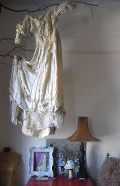 Cool use for a vintage dress...haunted decor