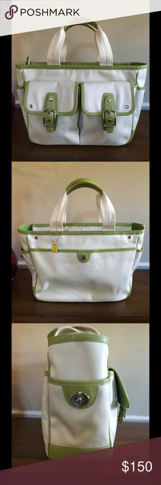Coach Hamptons Lg Canvas Tote Large double pocket tote. Roomy enough for a weekend trip or everyday. Multiple pockets. Front double pockets have magnetic closure. Cream canvas and green leather. Measures 17 x 5 x 10. (L/W/H). One tiny spot as seen in last photo. EUC Coach Bags Totes